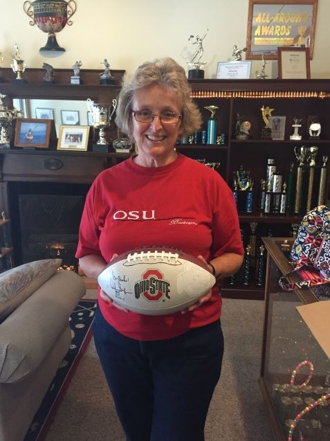 2015 Alan Galvez Insurance customer appreciation event- winner of the Archie Griffin signed football