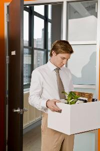 employee packing up items from office