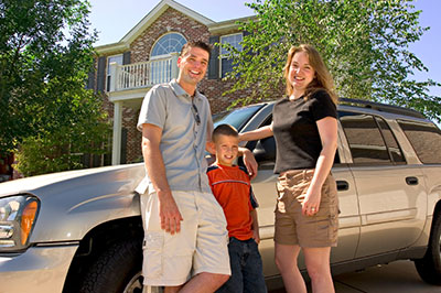 image of family outside home