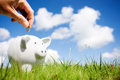 money being put into a piggy bank for retirement savings