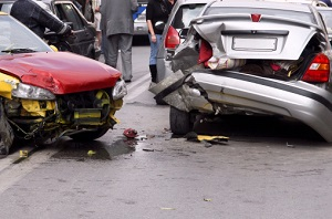 red and silver cars that have been in an accident
