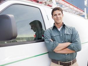 man standing next to commercial van