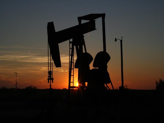 oil well drilling at dusk