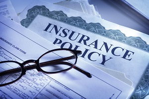 insurance policy with a pen and glasses