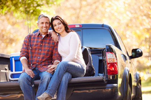 Couple and truck outside in the Fall