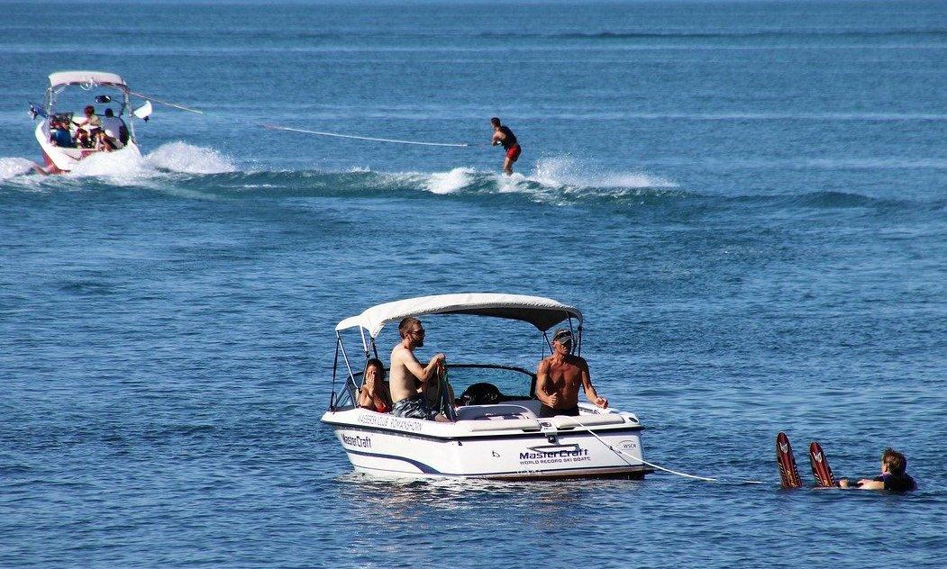 Water ski boats on lake