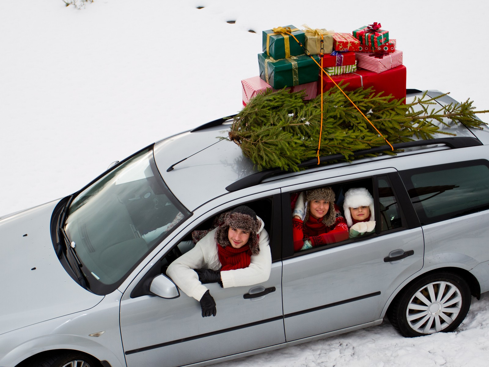 Family in Christmas car