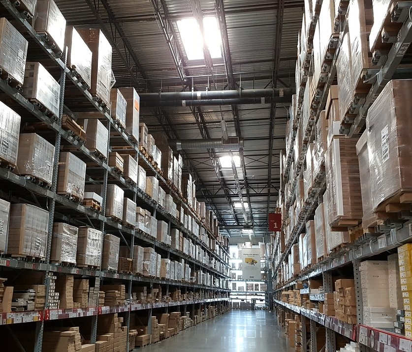 warehouse with inventory stacked up on tall shelves