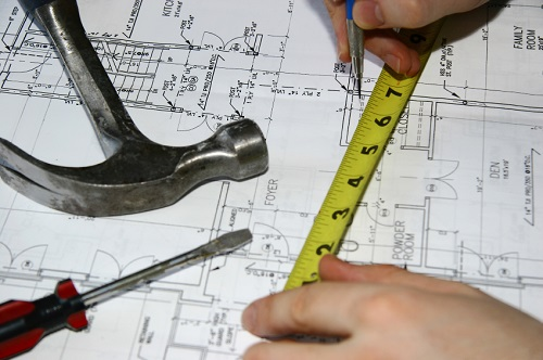 worker measuring for home improvement business