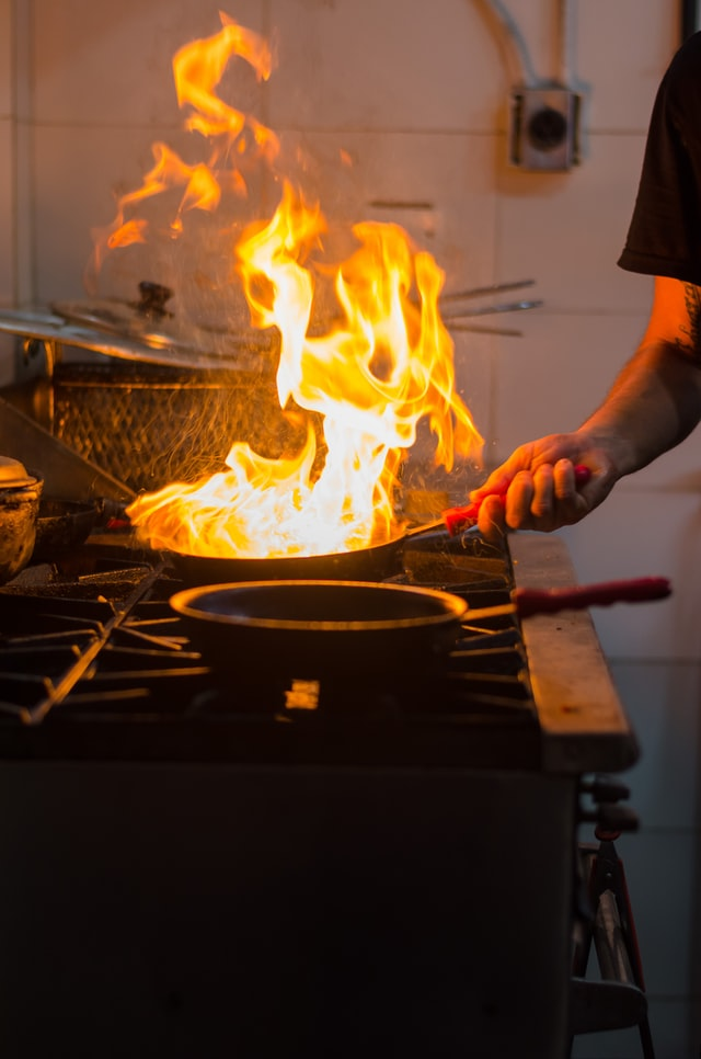 fire in pan on stove