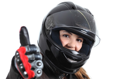 Woman in helmet giving thumbs up