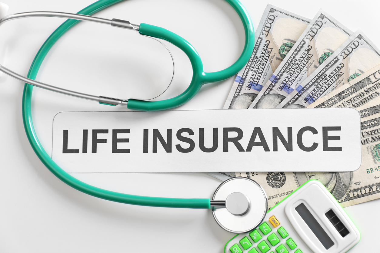Life insurance with stethoscope and money.