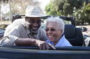 elderly couple in car