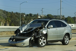 silver car that has been in an accident