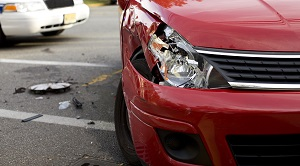 front of a red car that has been in an accident